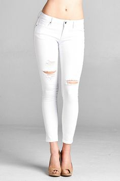 Super soft, stretchy white denim knee destroy detail in ankle skinny. Model is wearing size 3. You can rest assured no one will be seeing what's underneath because this white denim is NOT see through. Pair with sandals and an oversized blouse for brunch with the girls or some strappy black heels and a sexy top for a night out on the town. White Skinny Denim  by Special A. Clothing - Bottoms - Jeans & Denim - Skinny California