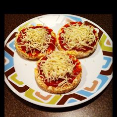 Yummy snack...Quaker white cheddar rice cakes, Contadina pizza squeeze sauce and shredded mozzarella cheese