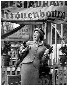 Dorian Leigh in suit and hat by Jacques Griffe, photo by Georges Dambier, ELLE, March 4, 1957