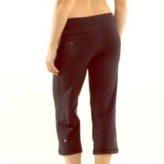 LuluLemon cropped wide leg pants LuluLemon cropped wide leg pants. These have a light grey colored designs. LuluLemon emblems with shells and coral. These are wide leg. They have a draw string and the waist. Fair condition. lululemon athletica Pants Ankle & Cropped