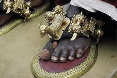 Africa | Details of the gold leaf covered shoes of the King of Bonoua, at a festival.  Ivory Coast | ©Georges Courreges