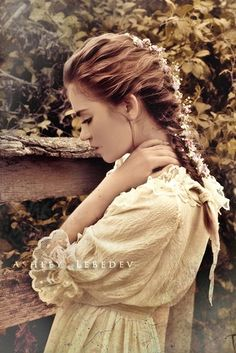 Not only do I love the braid with the flowers, I love the dress. Very old fashioned looking.