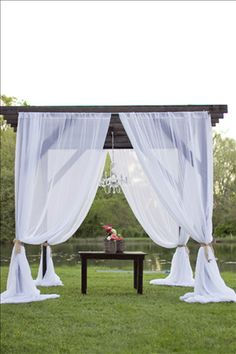 white drapes pergola wedding