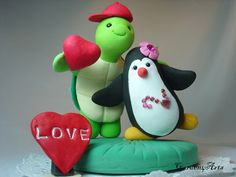 Customise Happy Turtle and Penguin Love Wedding Cake Topper with Red Heart and Grass Base. $75.00, via Etsy.