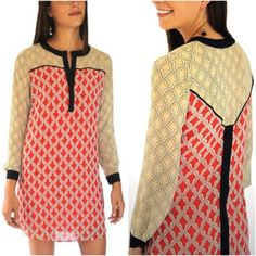 Tunic Dress Long sleeve tunic dress Sheer long sleeves Lined under red print Buttons down to chest, black outline. 100% polyester Style Tip:  This looks great with leggings! Lemieux Dresses Long Sleeve
