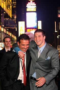 Coach Meyer and Tim Tebow celebrating Tebow's Heisman win (2007)