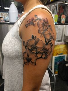 Orchids done by Carlos Montilla at Visible Ink Malden MA