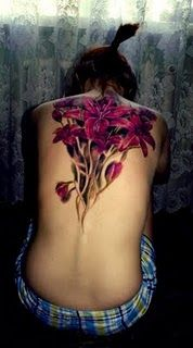 lilies - gorgeous.  Inspired a tattoo thought: flowers growing out of a woman's spine, much like this.  Growing up and out to cover her upper back.