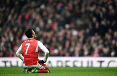 Alexis Sanchez of Arsenal reacts after missing a chance during the Premier League match between Arsenal and Hull City at Emirates Stadium on February 11, 2017 in London, England.