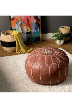 Leather Poof | If your loved one is looking for that global inspiration to complete a room, this distinctive Moroccan leather pouf could be the perfect finishing touch. More details here... #leathergifts #weddinganniversary #anniversarygifts #weddinganniversarygifts #thirdweddinganniversary