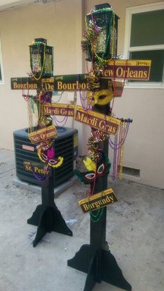 Mardi Gras Lamp Post - $1 Tree decor - $20, Lowes for the wood, stands, paint - $60, lamps from IKEA - $7 each, Street signs from EBAY - $8