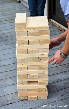 Super-size your Jenga with a bunch of wood blocks. Give the game an exciting look by painting the pieces different colors! Get the tutorial at Love Bug Living.   - CountryLiving.com
