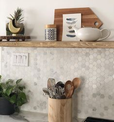 In an effort to maintain continuity through our main living areas we carried the wood floating shelf into the kitchen. Wood, Living Area, Shelves, Wood Floating Shelves, Floating, Home Decor, Kitchen, Areas