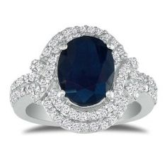 [Oval Blue Sapphire and Diamond Ring] Price: $699.00. The ring is beautiful. Diamonds are clear, the Sapphire is large. It is a navy blue in color. Good weight and is true to size. Band is a good is not too thick. http://www.amazon.com/gp/product/B0026740TM?ie=UTF8=exotbalihan00-20=xm2=1789=B0026740TM