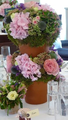 Amazing table arrangement for a summer wedding. Made by The Flower Academy Inc Ltd. www.thefloweracademy.org.