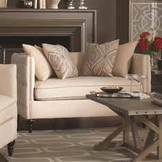 Small loveseat or large chair...no matter how you choose to look at it, this living room furniture piece has a distinct traditional romanticism to it. This chair and a half features a single seat cushion that offers lots of room. Decorative tufting on the tuxedo arms and seat back make this piece appealing to the eyes while beautiful legs add to the style. This piece includes the four accent pillows as pictured.