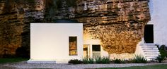 The Cuevas del Pino estate by UMMO Estudio is a 104-meter-square home built into calcarenite stone caves near Córdoba, Spain