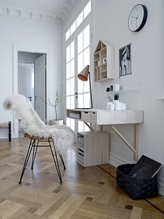 desk, clock, sheepskin, herringbone floor