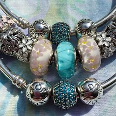 Pretty stack for a hot sunny day. #pandora #bracelets #pink #flower #beads #blue #teal #love