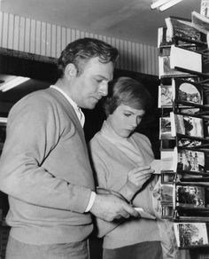 Christopher Plummer & Julie Andrews checking out postcards while doing publicity for The Sound of Music
