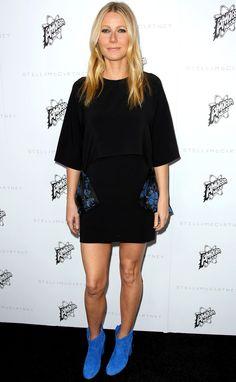 Gwyneth Paltrow in a black Stella McCartney mini dress and blue booties
