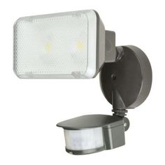 Aspects 180-Degree Motion Sensing Outdoor Black LED Flood Light-TPDW1300L50RBMS at The Home Depot. buy this for above garage door!! Mount it underneath.