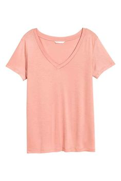 V-neck top: Short-sleeved V-neck top in softly draping airy jersey with a slight…