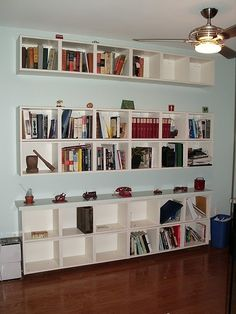 Turn a standard bookcase from Ikea horizontally and mount it to the wall to maximize book storage.