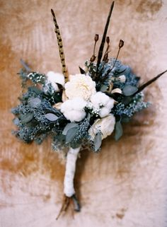 Deep Freeze: Icy Looks for Your Winter Wedding Blue & White Groom Flower Boutonniere