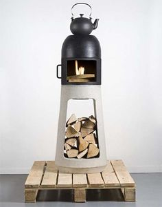 Small wood stove with kettle on top