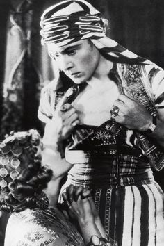"""Rudolph Valentino in the film """"Son of the Sheik"""" (1928) The Tank watch first appeared on screen when Rudolph Valentino insisted on wearing his Tank watch in The Son of the Sheik, creating one of the most famous anachronisms in the history of cinema."""