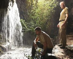 "1.13 ""Hearts and Minds"" – Publicity still. Jack and Locke at the caves. I can't find this in any Season 1 episode. I can't find this in any Season 1 deleted scene. But I like this picture, and it fits in this episode. This is how Jack and Locke were dressed on this day, they were on friendly terms, and after Locke left Boone to his own devices, he had some time to just hang out, talking to people."