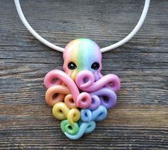 Pearl pastel rainbow octopus pendant 🌈 Colorful jewelry with polymer clay pastel rainbow octo with pearl effect. Leather or waxed cord at choice + additional chain Size of octopus is about: Large - inches or Small - inches ! Cute Polymer Clay, Polymer Clay Canes, Polymer Clay Necklace, Polymer Clay Pendant, Polymer Clay Projects, Polymer Clay Creations, Handmade Polymer Clay, Cute Clay, Clay Beads