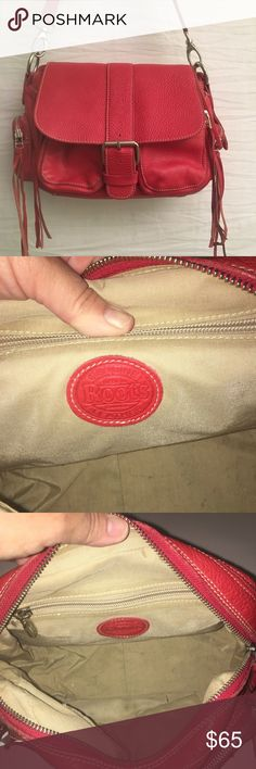 """Roots Genuine Leather Bag Great Condition! Roots Genuine Leather Bag Great Condition! Made in Canada. This handbag is made with the best quality leather! The color adds a ton of style to it! Magnetic closure. Two zip pockets in the front, one on each side. Fun tassels on each zipper pool. There are some ink marks on the inside of the bag. Measures approximately 12 x 9 x 4. Should strap drop is approximately 14 1/2"""". There are two more holes to make it longer. ROOTS Genuine Leather Bags"""