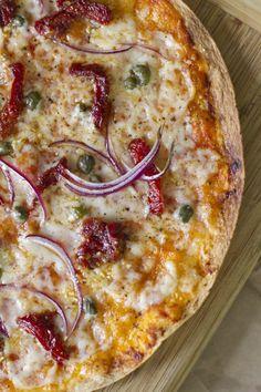 Mediterranean Tortilla Pizza with sun-dried tomato, capers & red onion