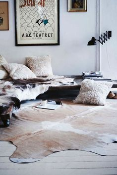 Love the cushions and rustic vibe of this room!