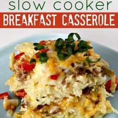 Slow Cooker Sausage Breakfast Casserole Recipe Breakfast and Brunch with hash brown potatoes, ground sausage, shredded cheddar cheese, shredded mozzarella cheese, onions, green pepper, red pepper, eggs, milk, salt, ground black pepper