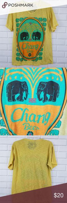 "Chang Beer Elephant Graphic T Shirt King of Singlet Chang Beer Elephant Graphic T Shirt  Pit to Pit: 19.75"" Approx Back Length: 25.5"" Approx  SKU: 499429 Najar Shirts Tees - Short Sleeve"