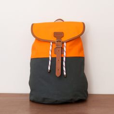 Shacklton / Rufus Rucksack. Colorblocking. Again I love the combo of canvas, leather, and outdoor-sporting rope.