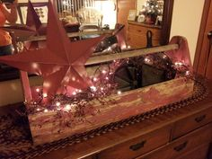 Antique wooden tool box, large star, cast iron skillets, berries and lights.