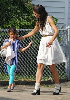 Suri Cruise gets a helping hand from mom.