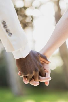 Beautiful -- bride and groom's intertwined hands