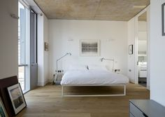 Gorgeous bedroom with perfect wood floors and modern white bed. Whitmore Rd Apartment by Trevor Horne Architects
