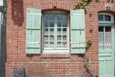 Brick exterior with green trimming, reminds me of my great-grandmother Tabor's house.
