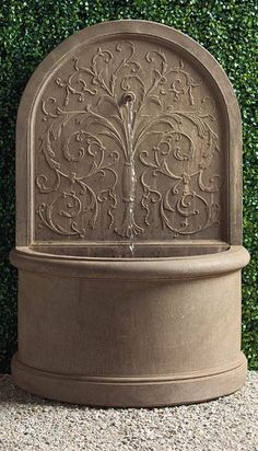 The classically inspired Corsini Water Fountain is as elegant as those found in quiet European courtyards. This handcrafted fountain is a work of art, with a peaceful stream of water cascading from the eloquently embossed back. Ideal for tighter spaces, the fountain sits almost flush against a garden or patio wall. Stone Fountains, Patio Wall, Classic Garden, Gallon Of Water, Dog Sculpture, Dazed And Confused, Garden Oasis, Action Poses, Courtyards