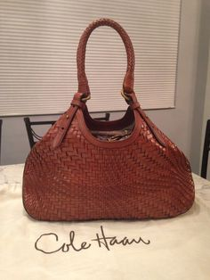 Cole Haan Genevieve Woven Leather Hobo Satchel Handbag Saddle Brown Cognac Tote Bag. Get one of the hottest styles of the season! The Cole Haan Genevieve Woven Leather Hobo Satchel Handbag Saddle Brown Cognac Tote Bag is a top 10 member favorite on Tradesy. Save on yours before they're sold out! GORGEOUS!!! BEAUTIFUL SADDLE BROWN/ COGNAC BROWN COLOR!!! SALE!!! WOW!!!