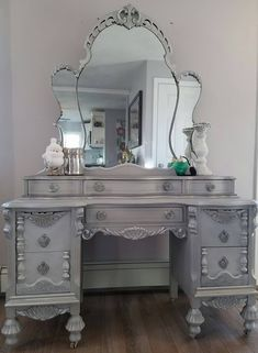 This amazing 1932's Vintage Vanity & Mirror were requested to coordinate with the Jacobian buffet I recently refinished for a client. White, gray chalk paint, slightly distressed, silver gilding wax, General Finishes brown glaze. Then I refinished and added new fabric to a vintage chair I had and wow! This is so beautiful. So very happy with how this came out! Love, love it Repurposed, up-cycled, DIY