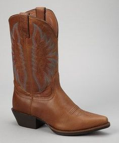 Cowgirls will swoon over the full-grain leather construction and classic embroidery of this pointed-toe western boot. A cushioned footbed and chunky heel create a comfortable fit with a supportive lift.