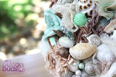 Shells & Fabric combine to make a great bouquet for a beach wedding