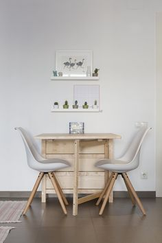 The dinner table is perfect for two, but when they have guests it can be expanded to accommodate more people.